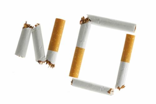 """Word """"NO""""  made from broken cigarettes isolated over whte background"""